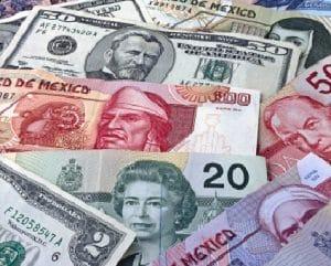 شكل عمله الدولار الأمريكي والدولار الكندي